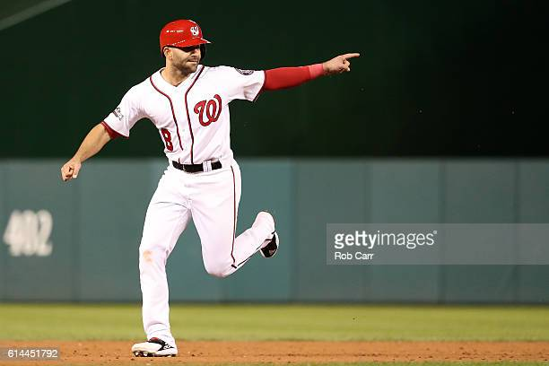Danny Espinosa of the Washington Nationals celebrates after teammate Chris Heisey hits a two run home run in the seventh inning against the Los...