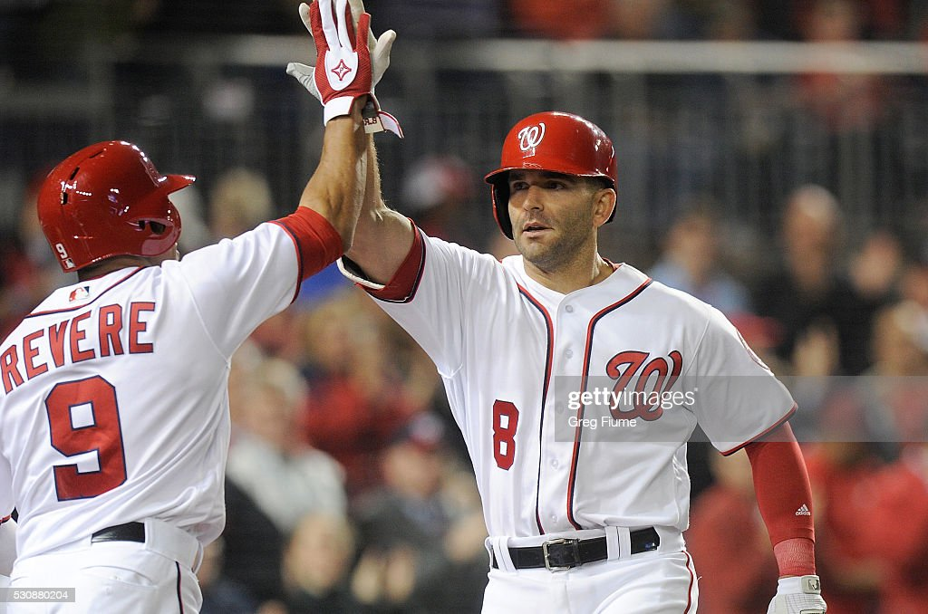 Danny Espinosa #8 of the Washington Nationals celebrates with Ben Revere #9 after hitting a home run in the seventh inning against the Detroit Tigers at Nationals Park on May 11, 2016 in Washington, DC. Washington won the game 3-2.