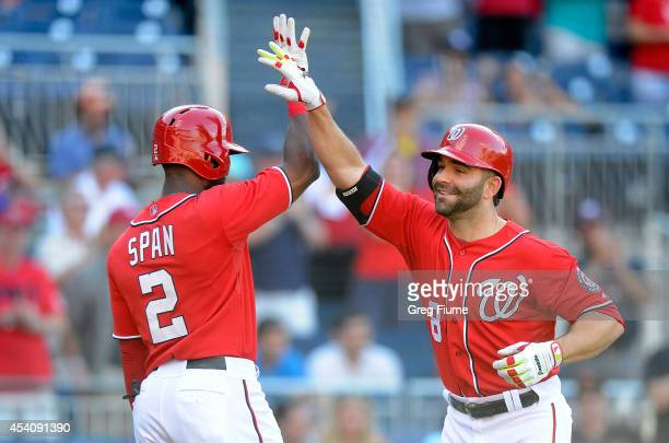 Danny Espinosa of the Washington Nationals celebrates with Denard Span after hitting a home run in the eighth inning against the San Francisco Giants...