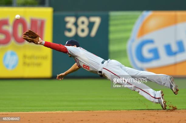 Danny Espinosa of the Washington Nationals dives for the ball in the second inning against the Philadelphia Phillies at Citizens Bank Park on July 11...