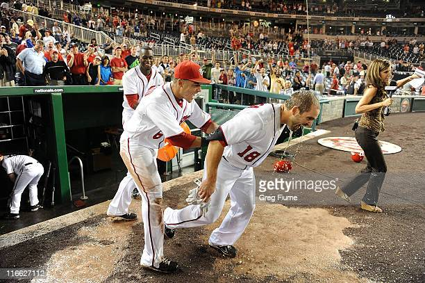 Danny Espinosa of the Washington Nationals gets doused with gatorade by Ian Desmond and Roger Bernadina after hitting the game winning three run home...