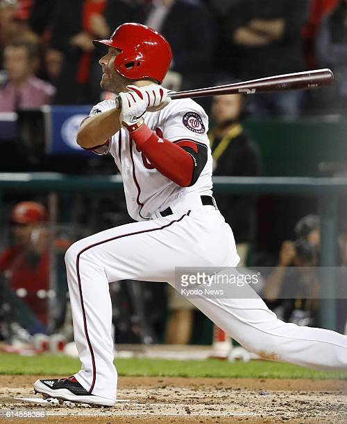 Danny Espinosa of the Washington Nationals hits an RBI single in the second inning of Game 5 of the National League Division Series against the Los...