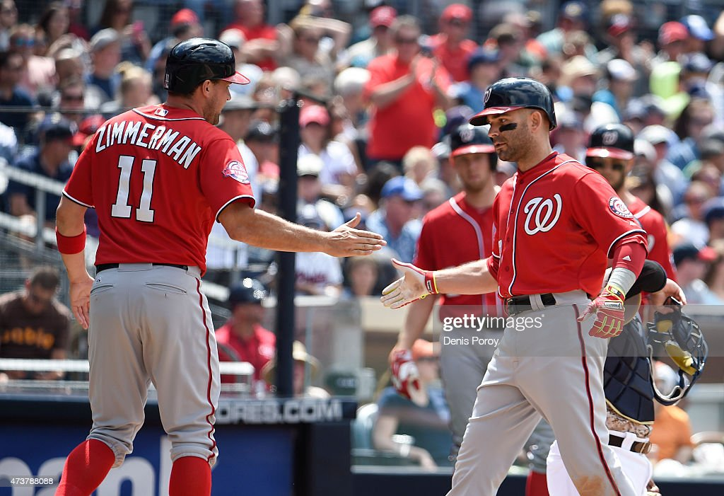 Danny Espinosa #8 of the Washington Nationals is congratulated by Ryan Zimmerman #11 after hitting a three-run home run during the fifth inning of a baseball game against the San Diego Padres at Petco Park May 17, 2015 in San Diego, California.