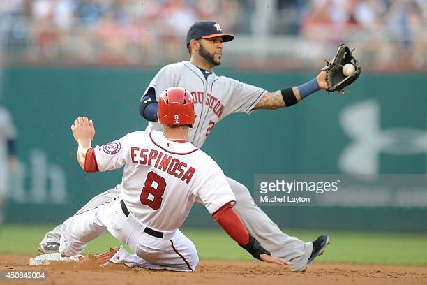 Danny Espinosa of the Washington Nationals is forced out by Jonathan Villar of the Houston Astros in the second inning during a baseball game on June...