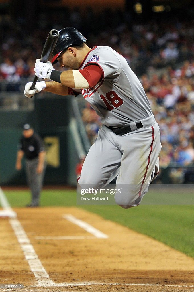 Danny Espinosa #18 of the Washington Nationals jumps to avoid being hit a by a pitch during the game against the Philadelphia Phillies at Citizens Bank Park on August 12, 2011 in Philadelphia, Pennsylvania. The Nationals won 4-2.