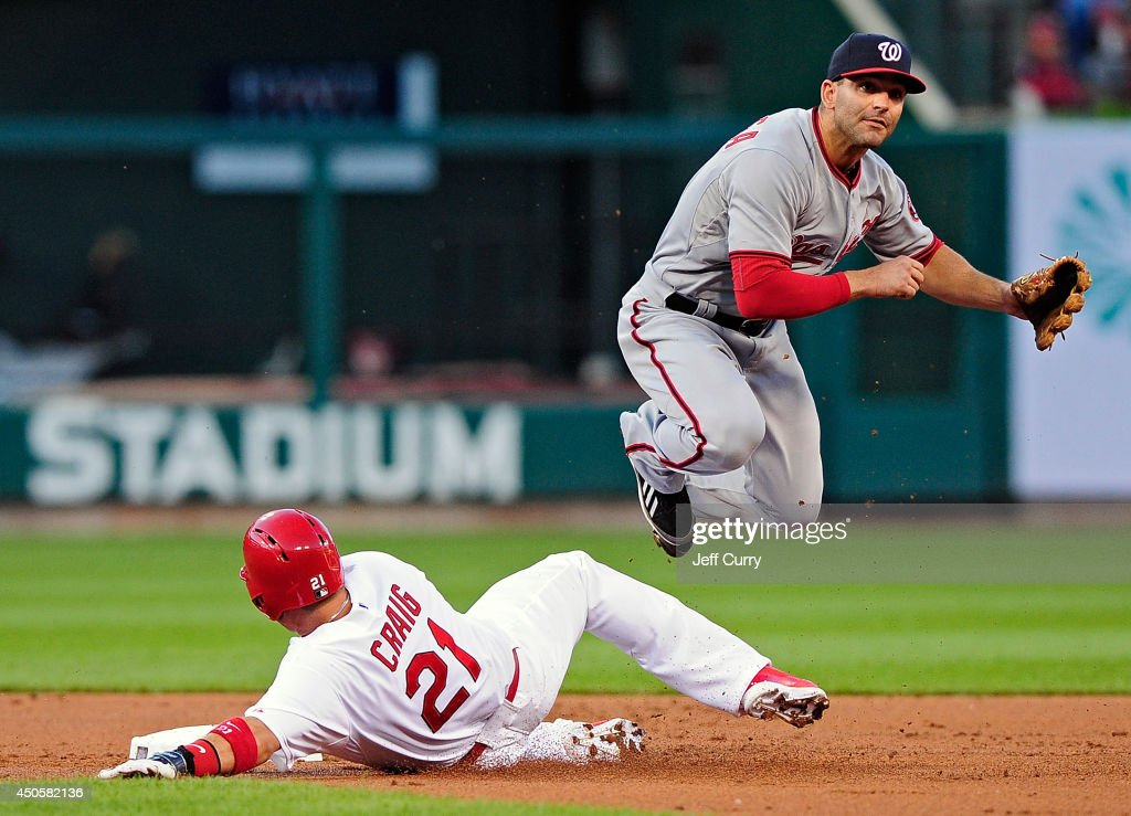 Danny Espinosa #8 of the Washington Nationals leaps over Allen Craig #21 of the St. Louis Cardinals as he completes the double play during the second inning at Busch Stadium on June 13, 2014 in St. Louis, Missouri.