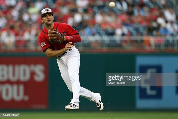 Danny Espinosa of the Washington Nationals makes a throw to first base for the second out of the seventh inning against the Milwaukee Brewers at...