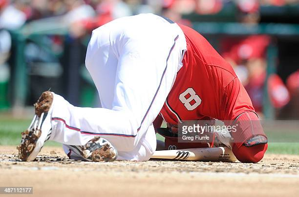 Danny Espinosa of the Washington Nationals on the ground after being hit by a pitch in the second inning against the San Diego Padres at Nationals...