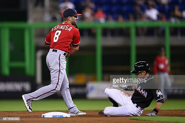 Danny Espinosa of the Washington Nationals turns a double play over Ichiro Suzuki of the Miami Marlins during the third inning of the game at Marlins...
