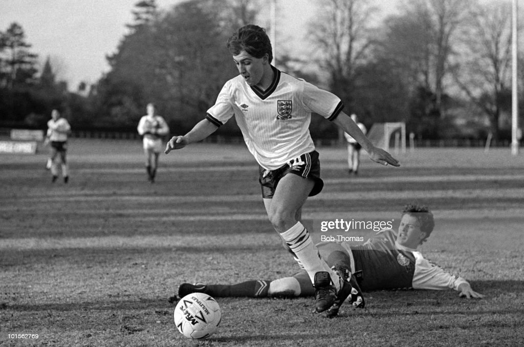 Danny Esquilant of England moves past Benny Mundt of Denmark before scoring the first goal during their Under-16 Intenational match held at the Football Association GM School in Lilleshall on 8th March 1986. England Under-16's beat Denmark Under-16's 3-0. (Bob Thomas/Getty Images).