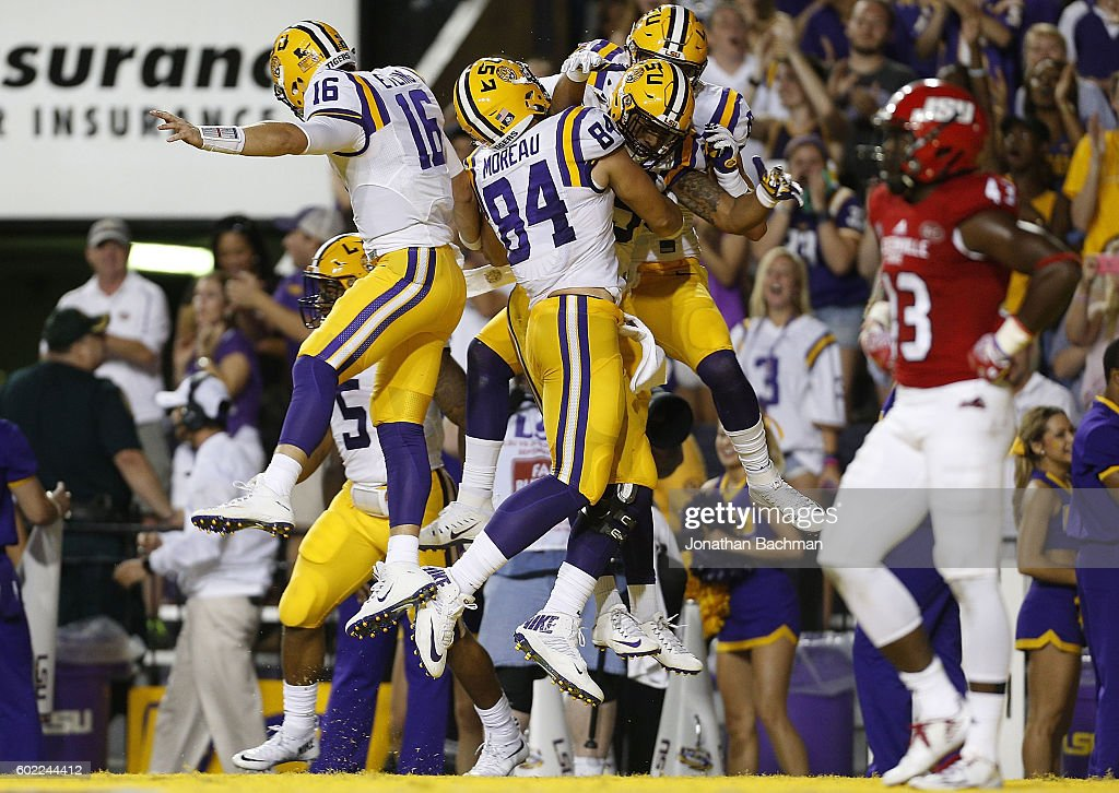 Danny Etling #16 of the LSU Tigers celebrates his touchdown with teammates during the first half of a game against the Jacksonville State Gamecocks at Tiger Stadium on September 10, 2016 in Baton Rouge, Louisiana.