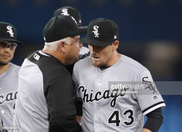 Danny Farquhar of the Chicago White Sox is relieved by manager Rick Renteria as he exits the game in the seventh inning during MLB game action...