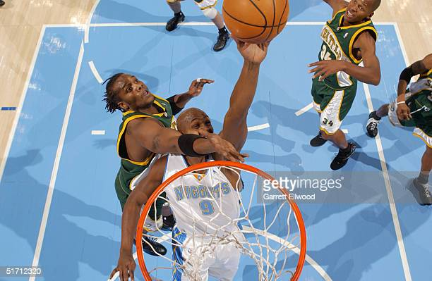 Danny Fortson of the Seattle Sonics fouls Bryon Russell of the Denver Nuggets on November 9 2004 at Pepsi Center in Denver Colorado NOTE TO USER User...