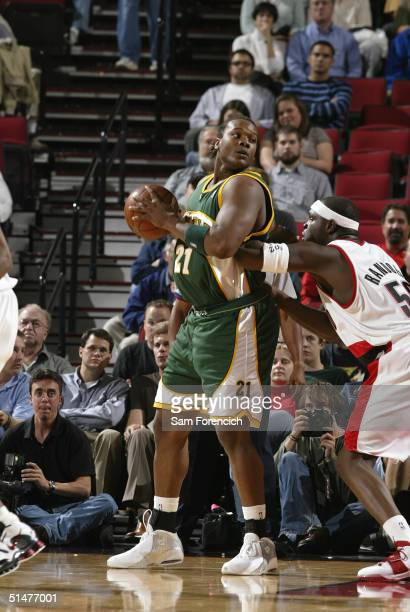 Danny Fortson of the Seattle SuperSonics goes up against Zach Randolph of the Portland Trail Blazers on October 13 2004 at the Rose Garden Arena in...