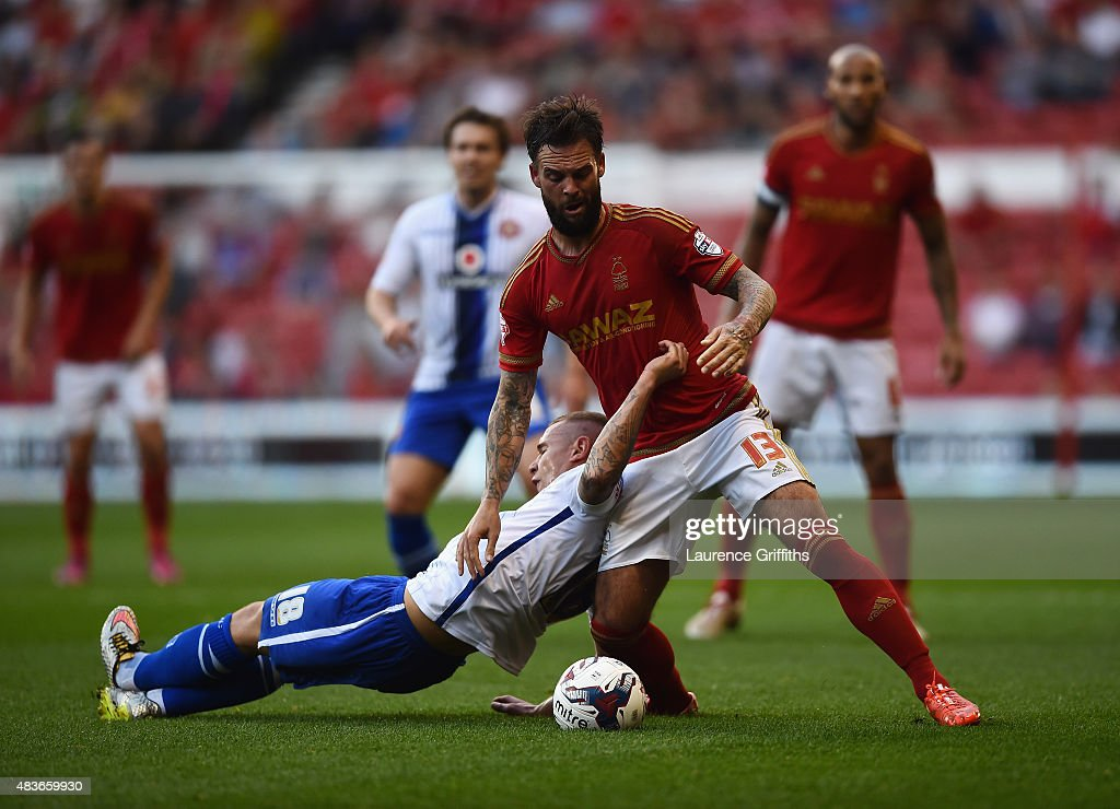 Danny Fox of Nottingam Forest battles with Kieron Morris of Walsall during the Capital One Cup First Round match between Nottingham Forest and Walsall at City Ground on August 11, 2015 in Nottingham, England.