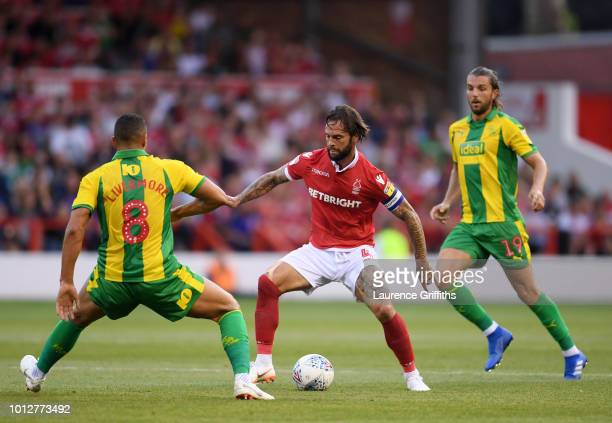 Danny Fox of Nottingham Forest is challenged by Jake Livermore of West Bromwich Albion during the Sky Bet Championship match between Nottingham...
