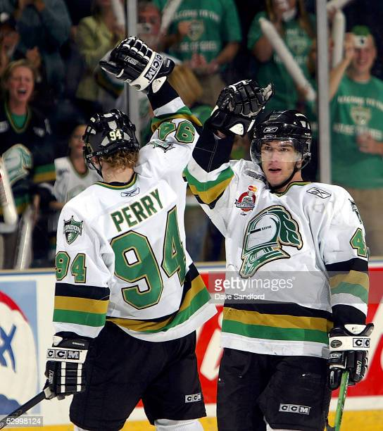 Danny Fritsche of the London Knights celebrates a goal with teammate Corey Perry against the Rimouski Oceanic during the Memorial Cup Tournament...