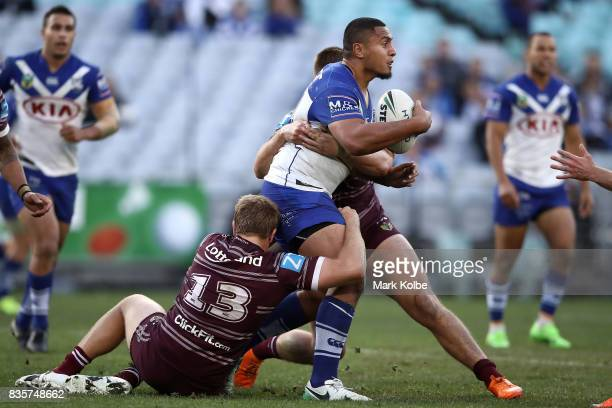 Danny Fualalo of the Bulldogs is tackled during the round 24 NRL match between the Canterbury Bulldogs and the Manly Sea Eagles at ANZ Stadium on...