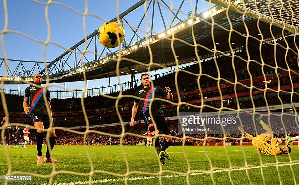 Danny Gabbidon Joel Ward and Julian Speroni of Crystal Palace look on as Alex OxladeChamberlain of Arsenal's effort hits the back of the net to score...