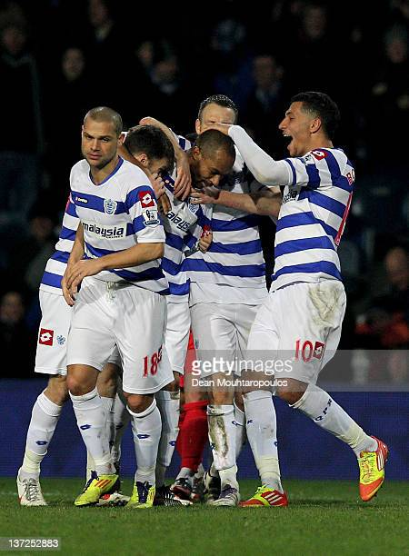 Danny Gabbidon of QPR is congratulated by teammates after scoring the opening goal with a header during the FA Cup third round replay between Queens...