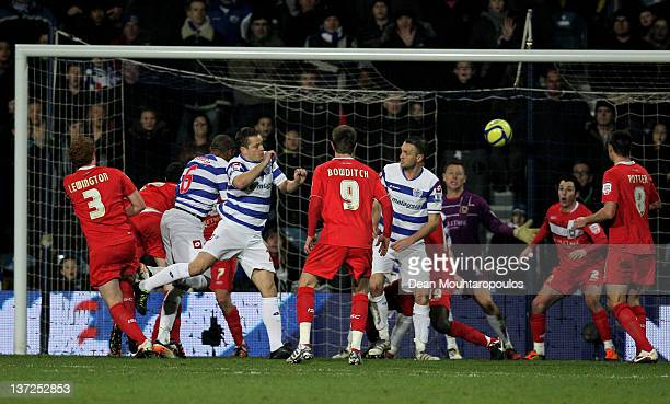 Danny Gabbidon of QPR scores the opening goal with a header during the FA Cup third round replay between Queens Park Rangers and MK Dons at Loftus...
