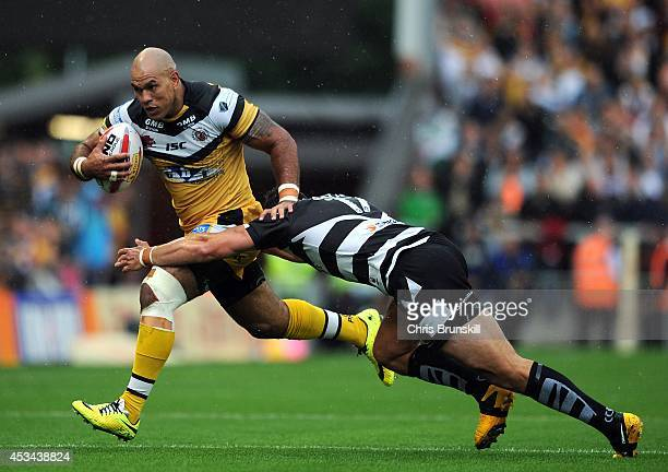 Danny Galea of Widnes Vikings tackles Jake Webster of Castleford Tigers during the Tetley's Challenge Cup Semi Final match between Widnes Vikings and...