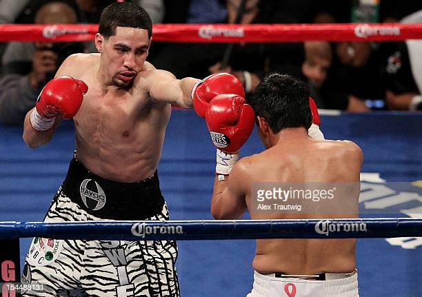 Danny Garcia and Erik Morales exchange punches during their WBA Super WBC Ring Magazine Super Lightweight title fight at the Barclays Center on...