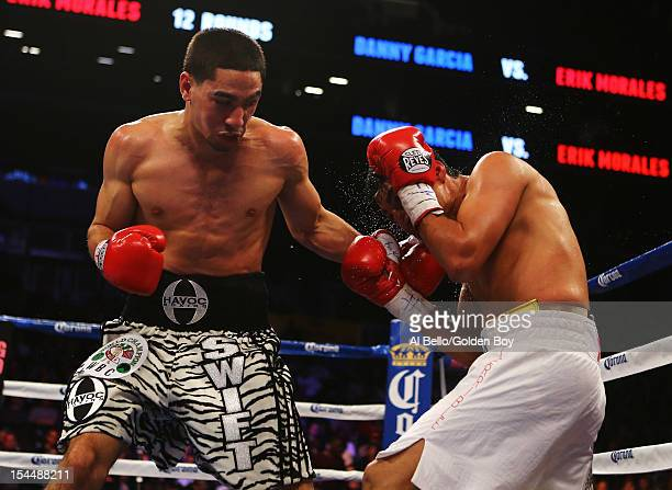 Danny Garcia and Erik Morales exchange punches during their WBC/WBA junior welterweight title at the Barclays Center on October 20 2012 in the...