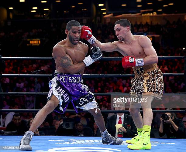 Danny Garcia and Lamont Peterson exchange blows during the Premier Boxing Champions Middleweight bout at Barclays Center on April 11 2015 in the...