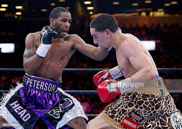 Danny Garcia and Lamont Peterson exchange pucnhes during the Premier Boxing Champions Middleweight bout at Barclays Center on April 11 2015 in the...