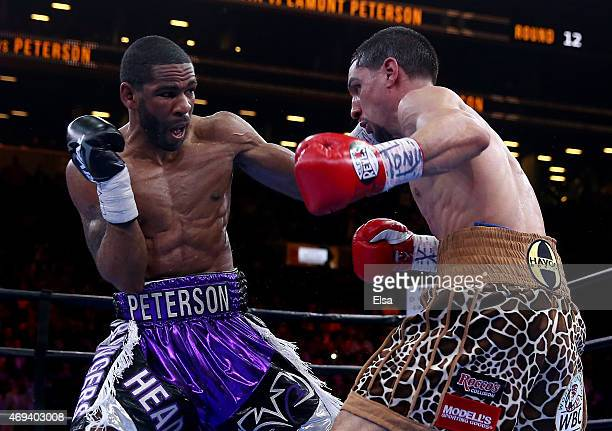 Danny Garcia and Lamont Peterson exchange punches during the Premier Boxing Champions Middleweight bout at Barclays Center on April 11 2015 in the...