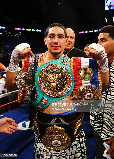 Danny Garcia celebrates his fourth round knockout of Erik Morales during their WBC/WBA junior welterweight title at the Barclays Center on October 20...