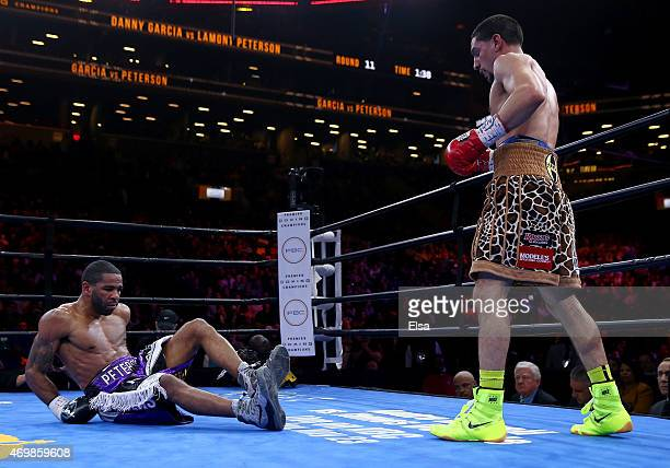 Danny Garcia knocks Lamont Peterson to the mat during the Premier Boxing Champions Middleweight bout at Barclays Center on April 11 2015 in the...