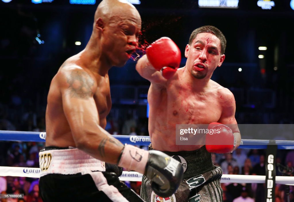 Danny Garcia punches Zab Judah during the WBA Super and WBC Super Lightweight title fight at Barclays Center on April 27, 2013 in the Brooklyn borough of New York City.Garcia was declared the winner after 12 rounds.