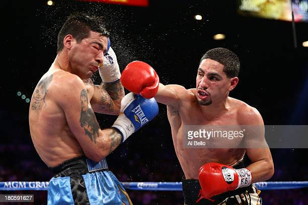 Danny Garcia throws a right to the head of Lucas Matthysse during their WBC/WBA super lightweight title fight at the MGM Grand Garden Arena on...