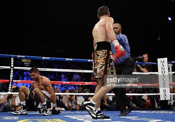 Danny Garcia walks back to his corner after knocking down Amir Khan of Great Britain during their WBC/ WBA Super Lightweight and vacant Ring Magazine...