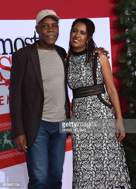 Danny Glover and wife Eliane Cavalleiro attend the premiere of Almost Christmas at the Regency Village theatre in Westwood California on November 3...