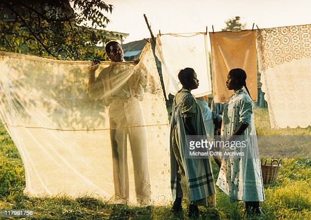 Danny Glover has designs on wife Desreta Jackson's sister Akosua Busia in a scene from the film 'The Color Purple' 1985