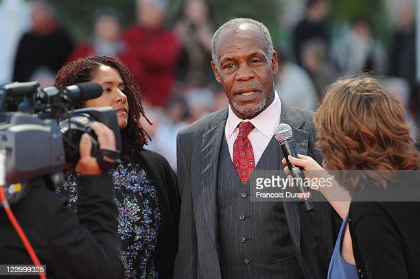 Danny Glover is interviewed as he arrives with Asake Bomani for 'The Conspirator' premiere during the 37th Deauville American Film Festival on...