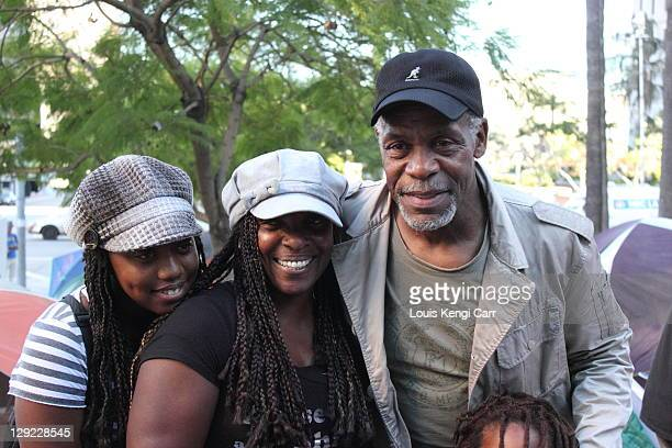 Danny Glover posing with people gathered at the Los Angeles City Hall in the Occupy LA camp.