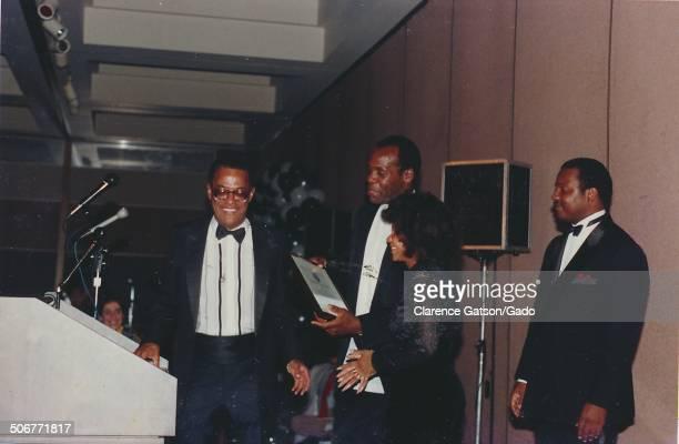 Danny Glover receiving an award San Francisco California 1990