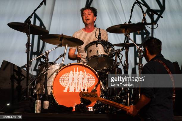 Danny Goffey and Mick Quinn of Supergrass perform at South Facing Festival on August 20, 2021 in London, England.