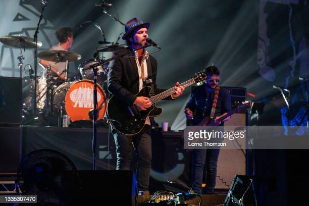 Danny Goffey, Gaz Coombes and Mick Quinn of Supergrass perform at South Facing Festival on August 20, 2021 in London, England.