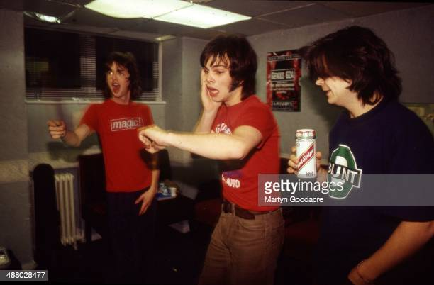 Danny Goffey, Gaz Coombes and Mickey Quinn of Supergrass, group portrait, backstage, United Kingdom, 1999.