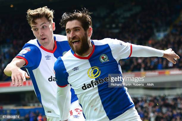 Danny Graham of Blackburn Rovers celebrates scoring the first goal with teammate Sam Gallagher during the Sky Bet Championship match between...
