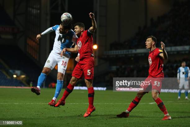 Danny Graham of Blackburn Rovers goes for the ball with Sam Morsy of Wigan Athletic during the Sky Bet Championship match between Blackburn Rovers...