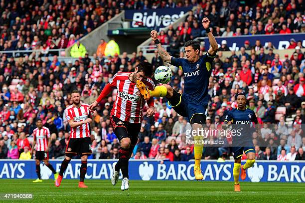 Danny Graham of Sunderland is challenged by Jose Fonte of Southampton leading to a penalty during the Barclays Premier League match between...
