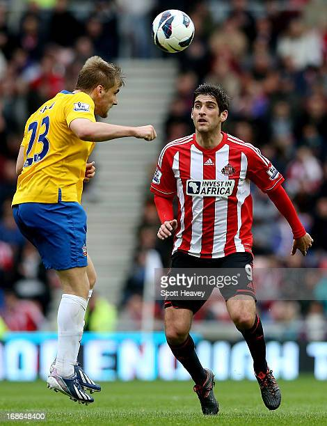Danny Graham of Sunderland looks on as Luke Shaw makes a clearance during the Barclays Premier League match between Sunderland and Southampton at the...