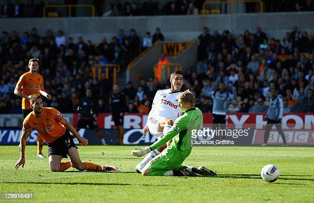 Danny Graham of Swansea City battles scores past Wayne Hennessey of Wolves during the Barclays Premier League match between Wolverhampton Wanderers...