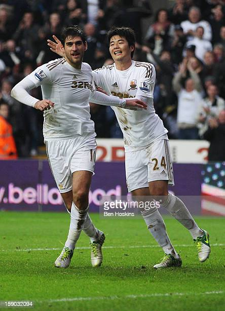 Danny Graham of Swansea City celebrates with Ki SungYong as he scores their second goal during the FA Cup with Budweiser Third Round match between...